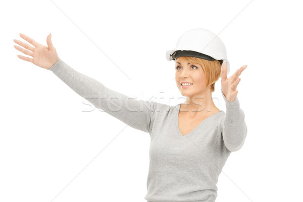 Homme casque travail quelque chose imaginaire Photo stock © dolgachov