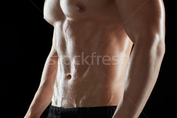 close up of man or bodybuilder with bare torso Stock photo © dolgachov