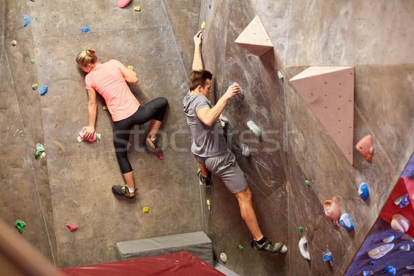 man and woman training at indoor climbing gym wall Stock photo © dolgachov
