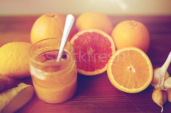 Miodu cytrus owoce imbir czosnku drewna Zdjęcia stock © dolgachov