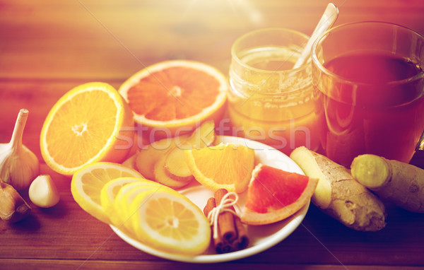 ginger tea with honey, citrus and garlic on wood Stock photo © dolgachov