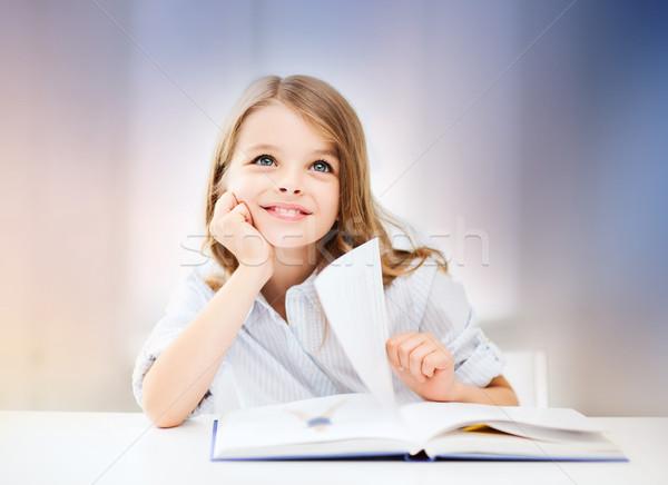счастливым улыбаясь студент девушки чтение книга Сток-фото © dolgachov