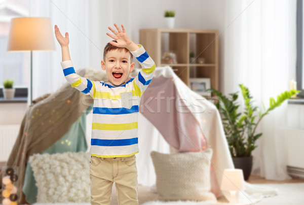 happy little boy waving hands at home Stock photo © dolgachov