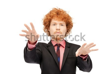 businessman working with something imaginary Stock photo © dolgachov