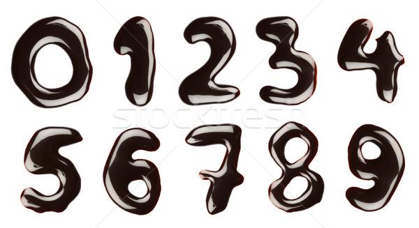 Csokoládé számok írott csokoládé szirup izolált étel Stock fotó © donatas1205