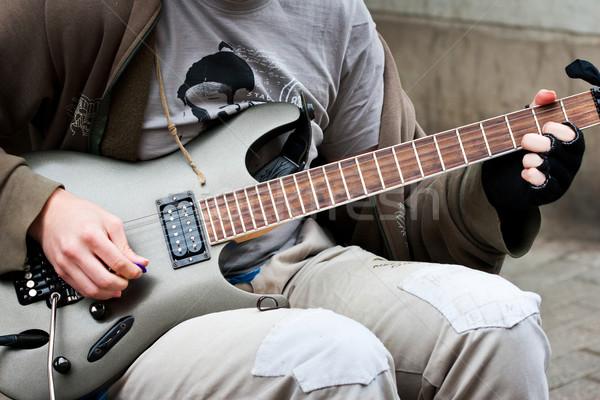 Utca zenész játszik elektromos gitár művészet kő Stock fotó © donatas1205