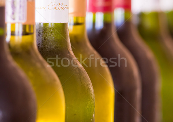 üvegek bor különböző egymásra pakolva háttér ital Stock fotó © Donvanstaden