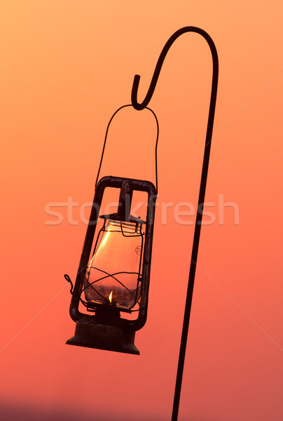 Ouragan lampe silhouette suspendu eau feu Photo stock © Donvanstaden