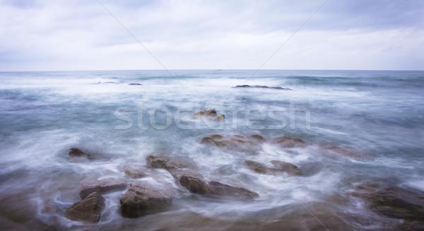 Durva óceán jelenet hullámok vízpart kövek Stock fotó © Donvanstaden