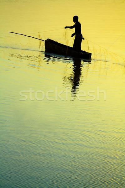 Hagyományos halász drámai naplemente fény tenger Stock fotó © Donvanstaden