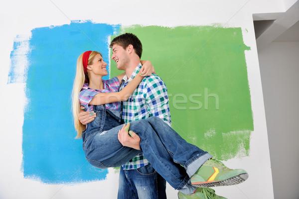 Feliz Pareja pintura pared nuevo hogar Foto stock © dotshock