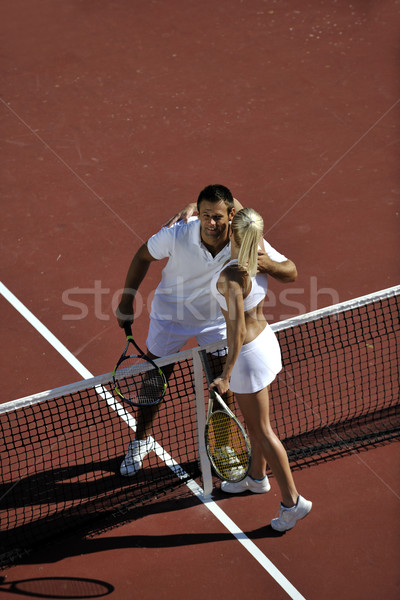 happy young couple play tennis game outdoor Stock photo © dotshock
