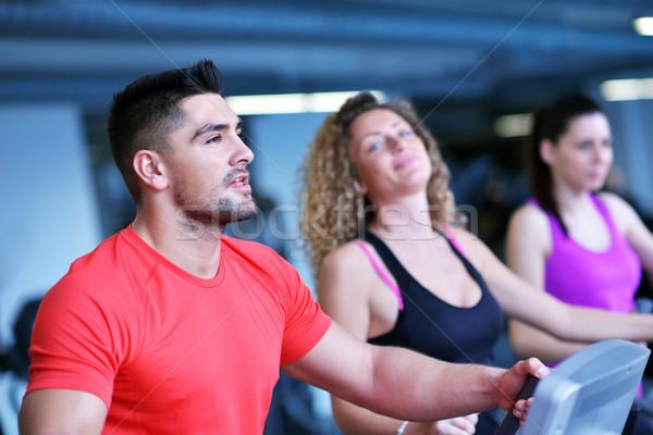 Stock photo: Group of people running on treadmills