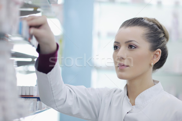 pharmacist chemist woman standing in pharmacy drugstore Stock photo © dotshock
