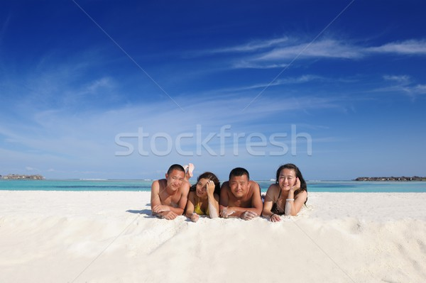group of happy young people have fun on bach Stock photo © dotshock