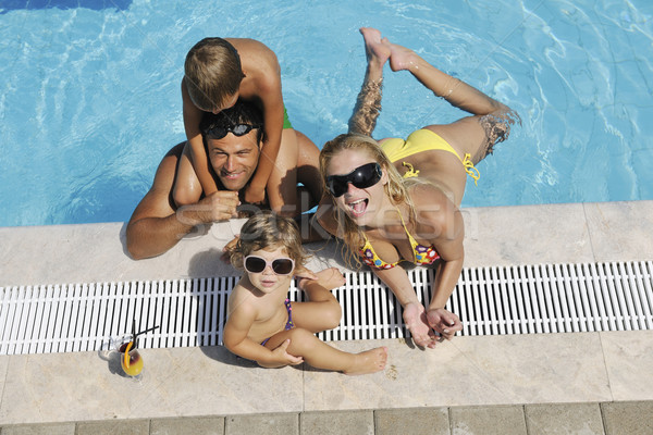 happy young family have fun on swimming pool Stock photo © dotshock