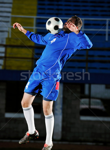 Futbolista acción futbolista patear pelota fútbol Foto stock © dotshock