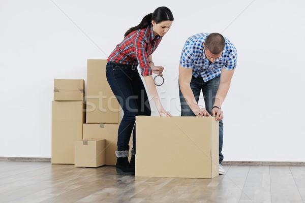 Fiatal pér mozog új ház boldog nő ház Stock fotó © dotshock