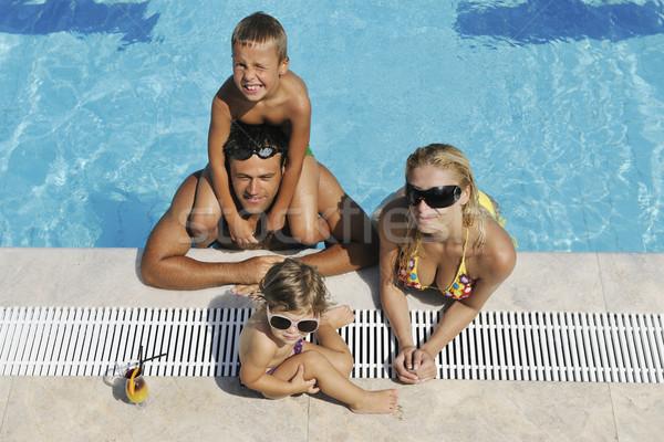 Stock fotó: Boldog · fiatal · család · jókedv · úszómedence · nyári · vakáció