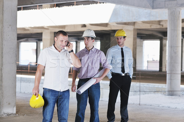 Team of architects on construciton site Stock photo © dotshock