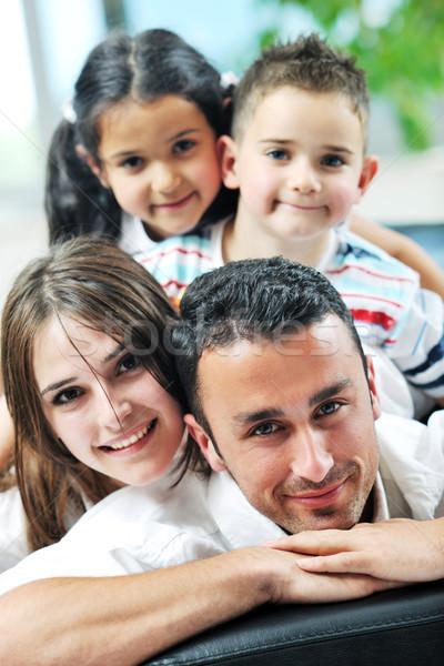 Fiatal családi otthon boldog család pihen jókedv Stock fotó © dotshock