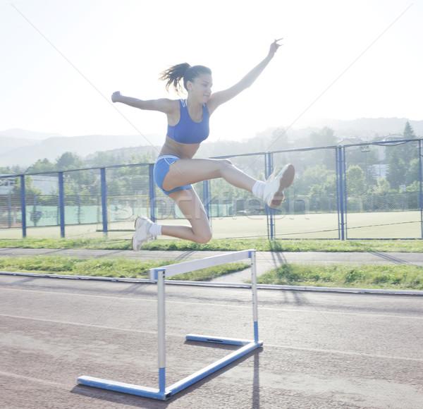 Vrouw jogging mooie jonge vrouw oefening Stockfoto © dotshock