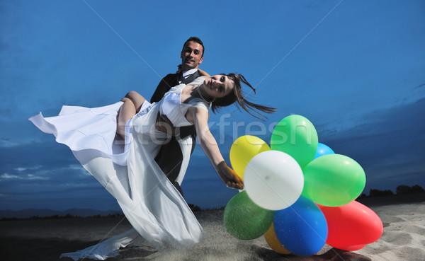 ストックフォト: ロマンチックな · ビーチ · 結婚式 · 日没 · 幸せ