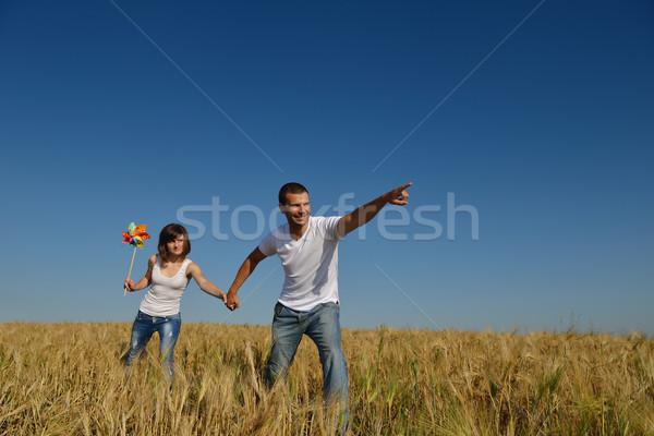 happy couple in wheat field Stock photo © dotshock