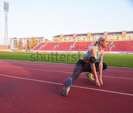 Athletic woman running on track Stock photo © dotshock