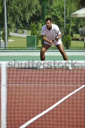 young man play tennis outdoor Stock photo © dotshock