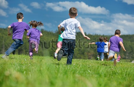happy kids group with teacher in nature Stock photo © dotshock