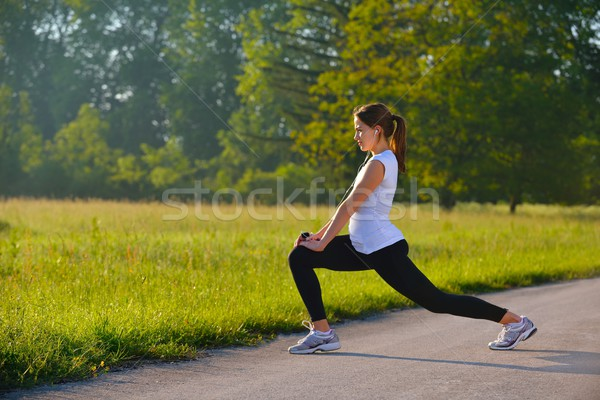 Stock photo: woman stretching before fitness