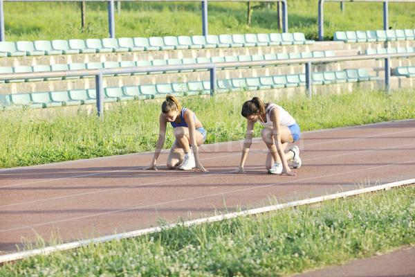 Kettő lányok fut sportos versenypálya fiatal lány Stock fotó © dotshock