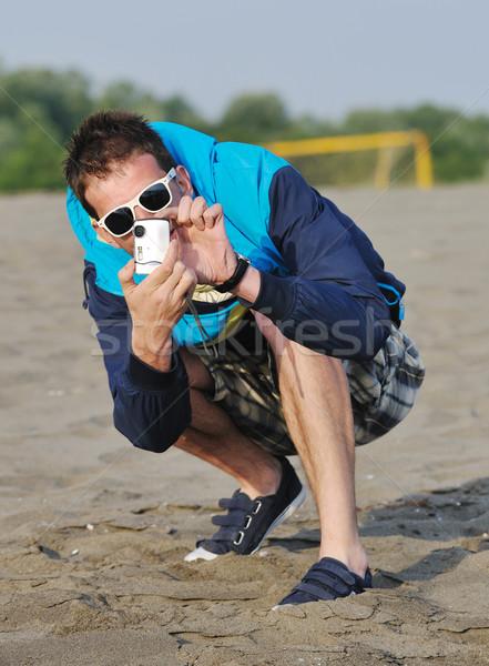Amator fotograf migawka Fotografia młodych Zdjęcia stock © dotshock