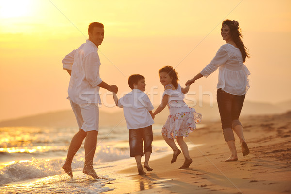 Stock photo: happy young family have fun on beach at sunset