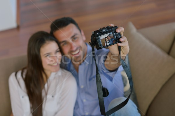 couple playing with digital camera at home Stock photo © dotshock