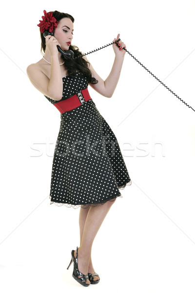 Stock photo: pretty girl talking on old phone
