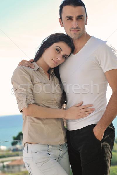 Pár megnyugtató erkély boldog fiatal pér szeretet Stock fotó © dotshock