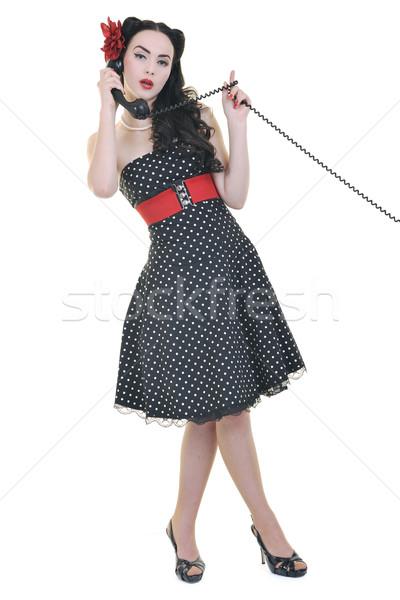 pretty girl talking on old phone Stock photo © dotshock