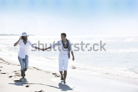 happy young couple have fun at beautiful beach Stock photo © dotshock