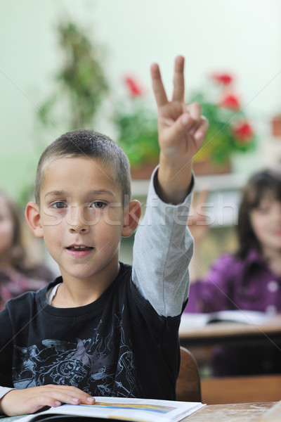 happy young boy at first grade math classes  Stock photo © dotshock