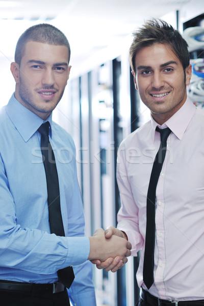 it engineers in network server room Stock photo © dotshock