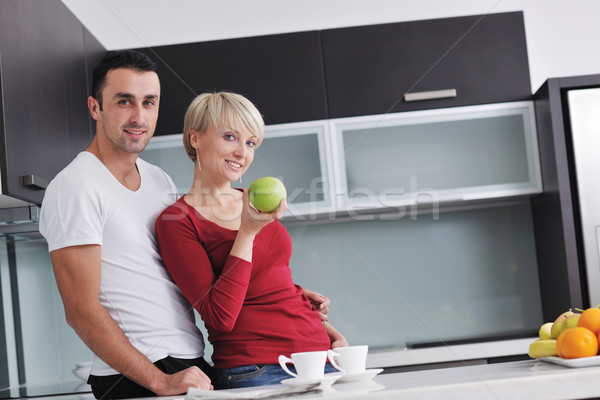 young couple have fun in modern kitchen Stock photo © dotshock