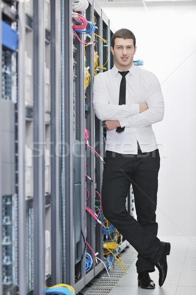 young engeneer in datacenter server room Stock photo © dotshock