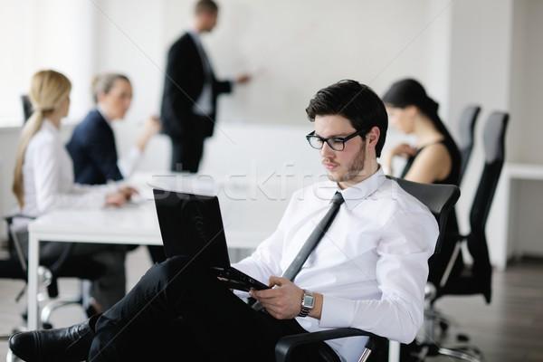 Portré jóképű fiatal üzletember kollégák emberek Stock fotó © dotshock