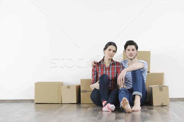 Fiatal pér mozog új otthon boldog nő férfi Stock fotó © dotshock