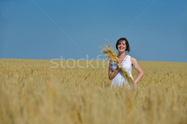 若い女性 麦畑 夏 立って ジャンプ を実行して ストックフォト © dotshock