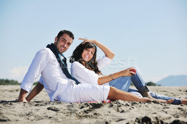 young couple enjoying  picnic on the beach Stock photo © dotshock