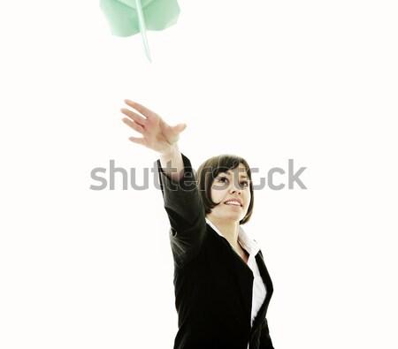 business woman throwing  paper airplane Stock photo © dotshock