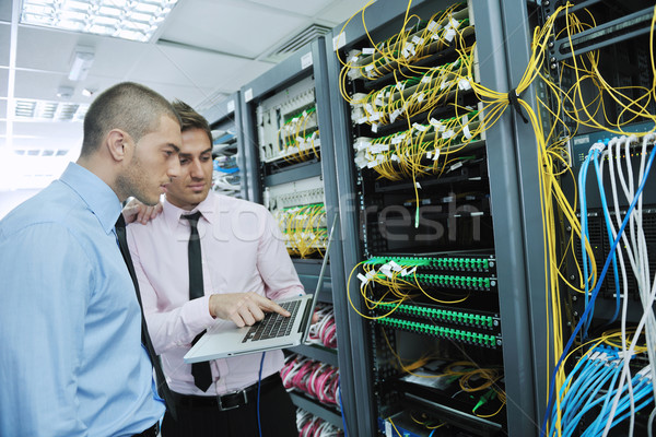 Stock photo: it engineers in network server room